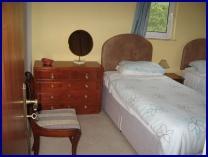slightly smaller twin bedroom